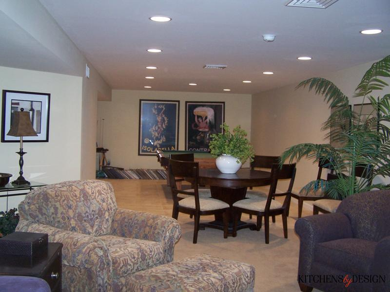 large entertainment basement with pool table and dining table