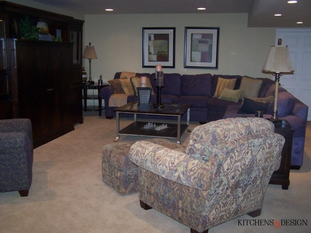 living area with couches and entertainment center