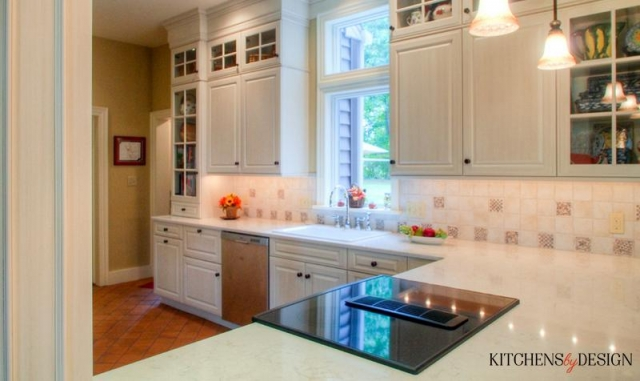classic style kitchen with grey cabinets and Italian look flooring