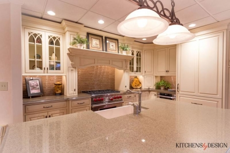 classic style kitchen with large island with sink and chef style stove