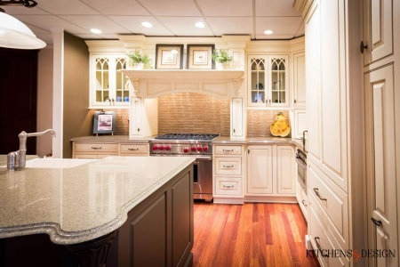 grand-looking kitchen with cream colored cabinetry and large island