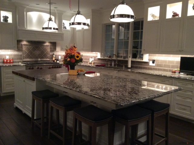 cabinetry and backsplash with custom installed back lighting