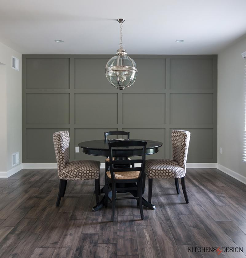 open feel dining room with hardwood flooring and sphere shaped chandelier