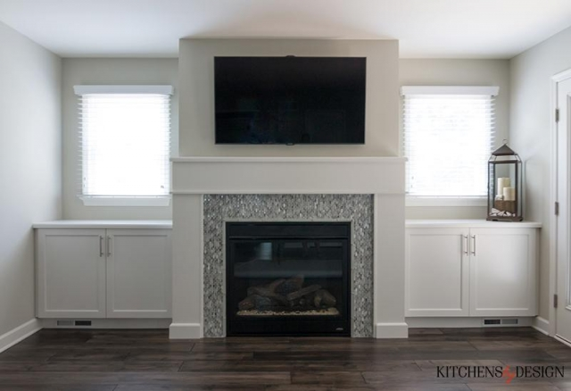 custom built-in fireplace with tv installed above