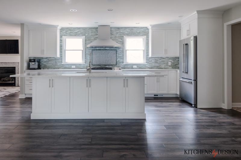 grey hardwood style flooring in bright, open kitchen