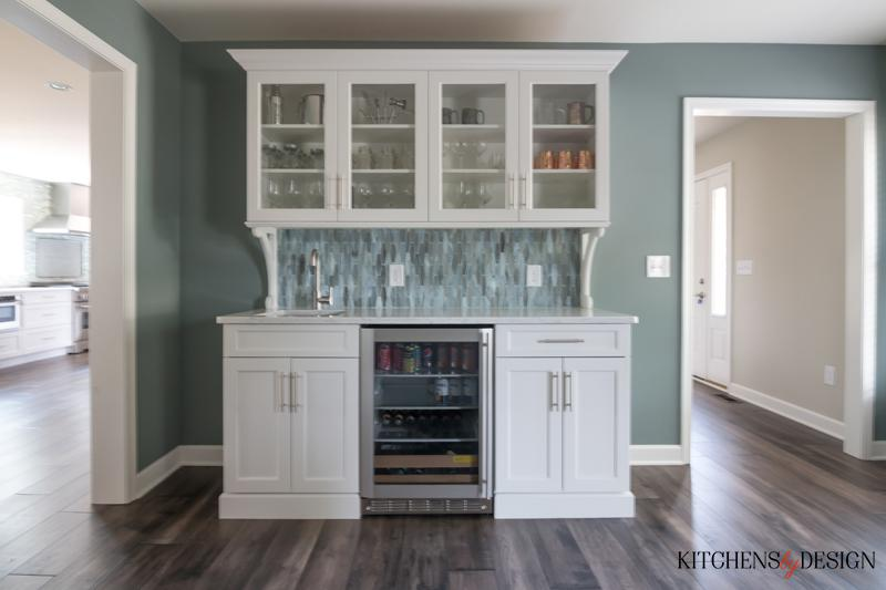 built-in hutch style cabinetry with sink and beverage refrigerator