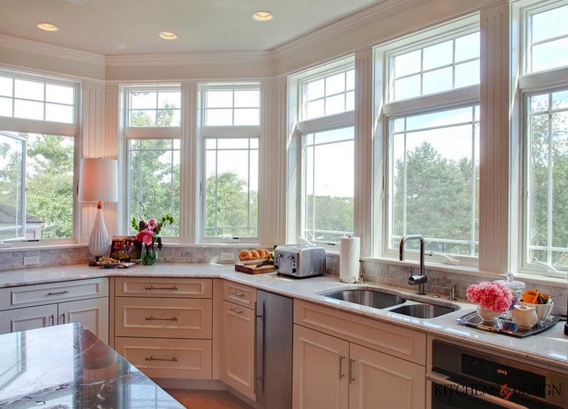 window lined kitchen with stainless steel accents