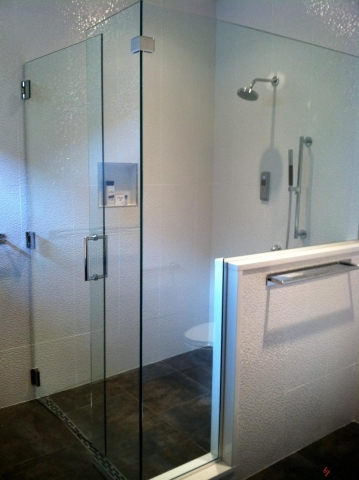 large glass shower with contrasting tiling