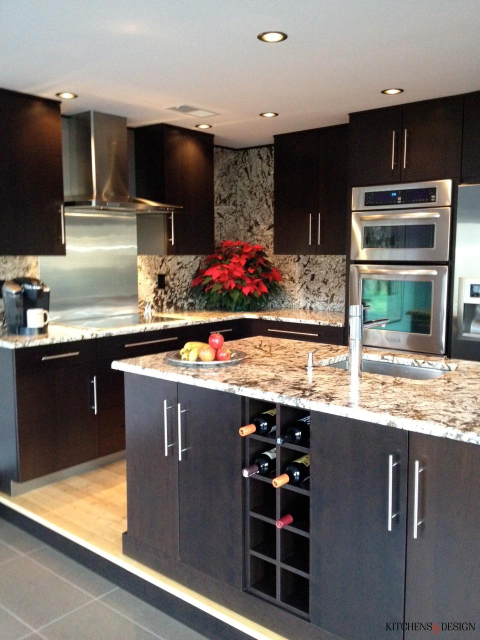 large kitchen with dark cabinetry and built-in wine rack