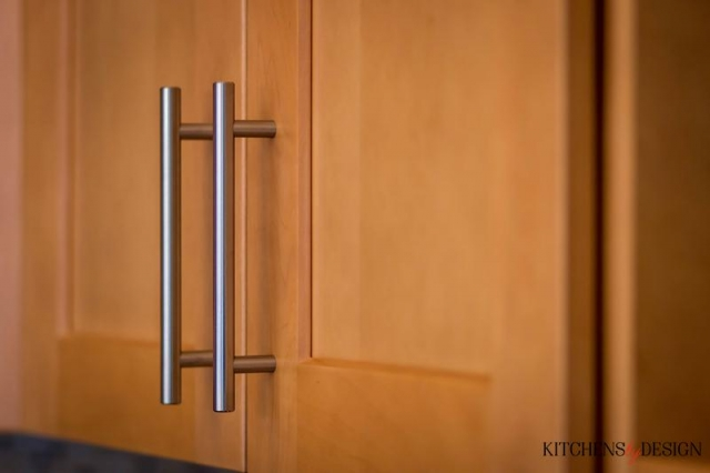 closeup of wood style cabinetry with modern hardware