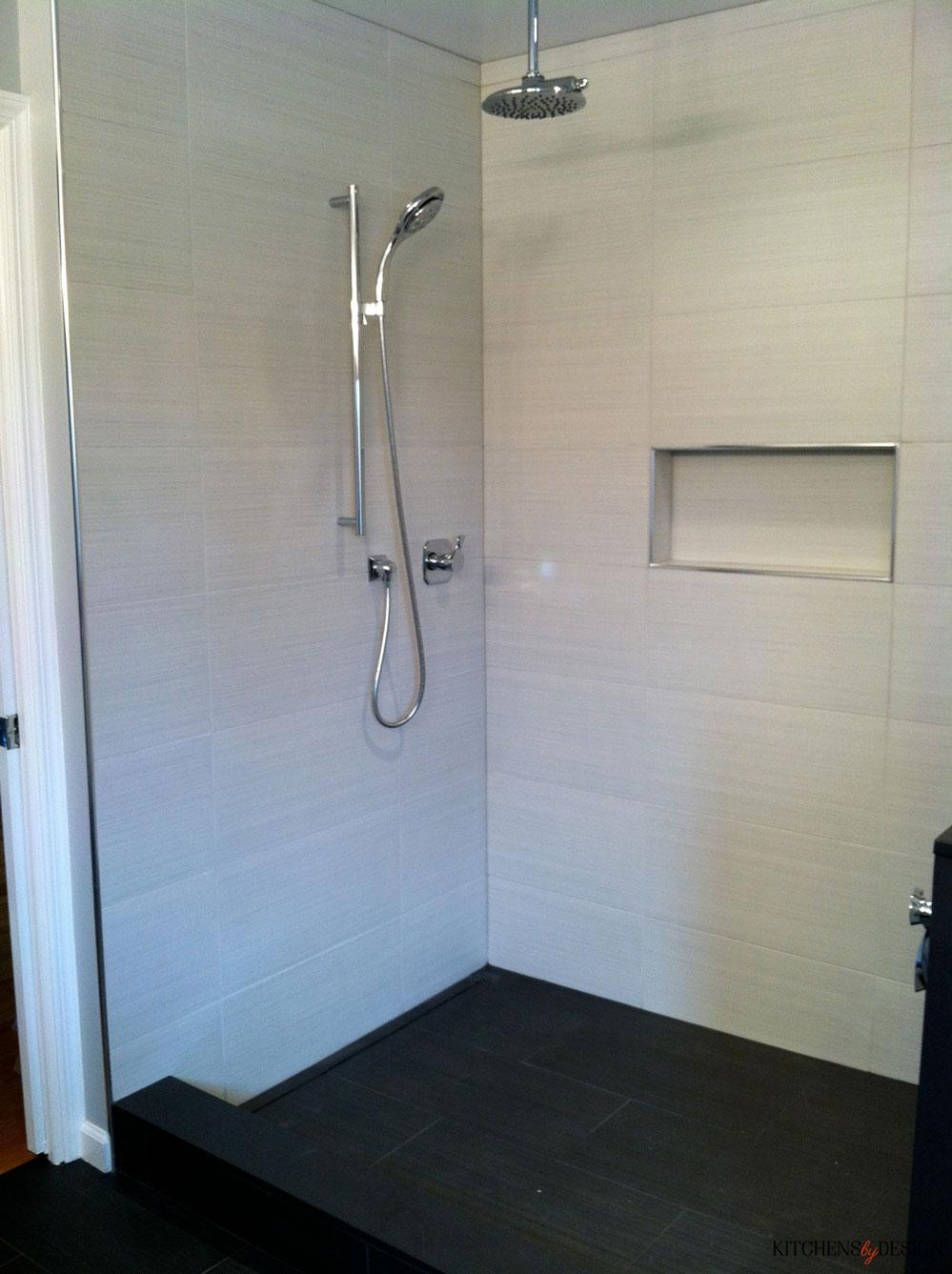 clean, white shower with dual shower heads
