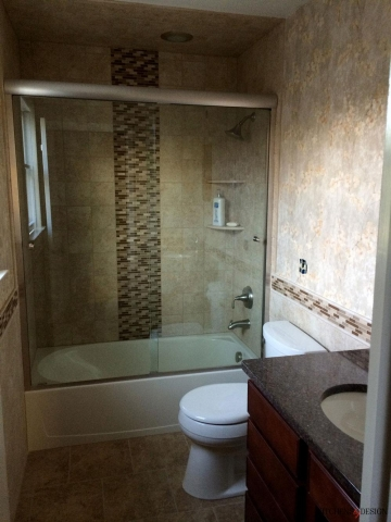custom tiling touches in shower and along bath wall