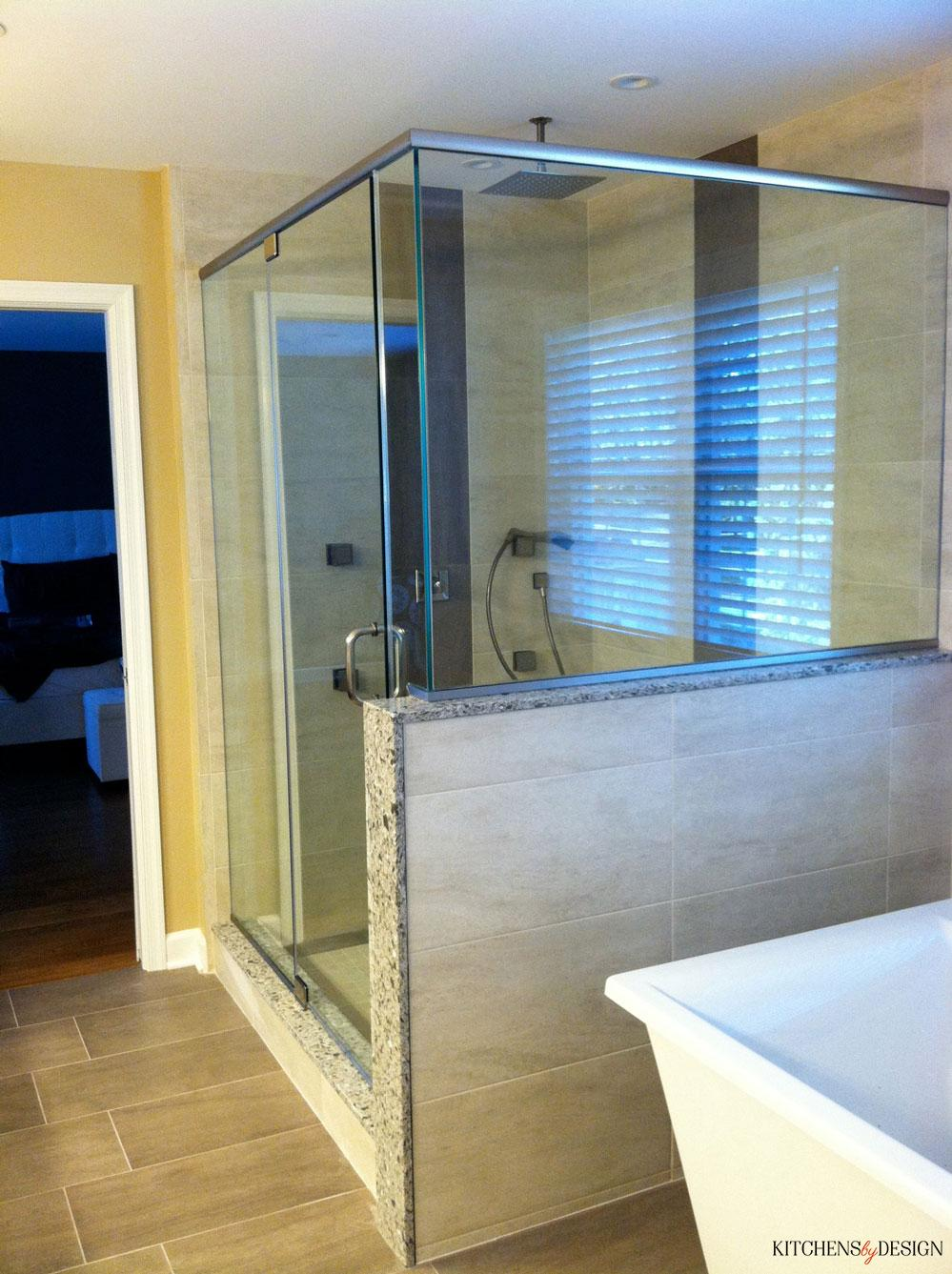 large glass shower with rainfall shower head